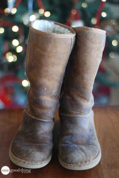 A pair of extremely dirty, worn, brown Ugg boots