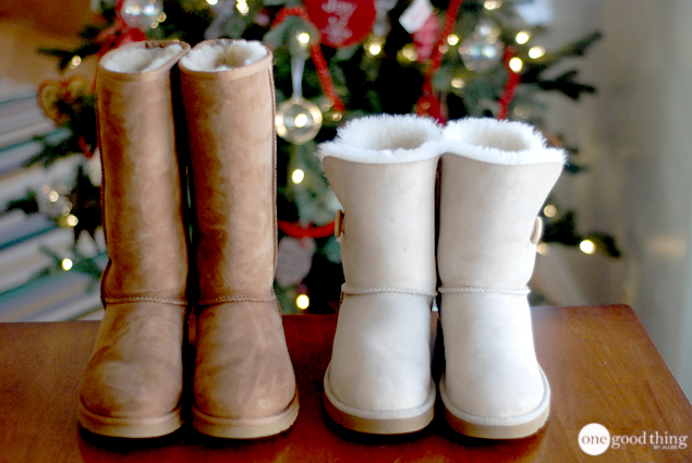 Two pairs of clean Ugg boots, one white and one brown