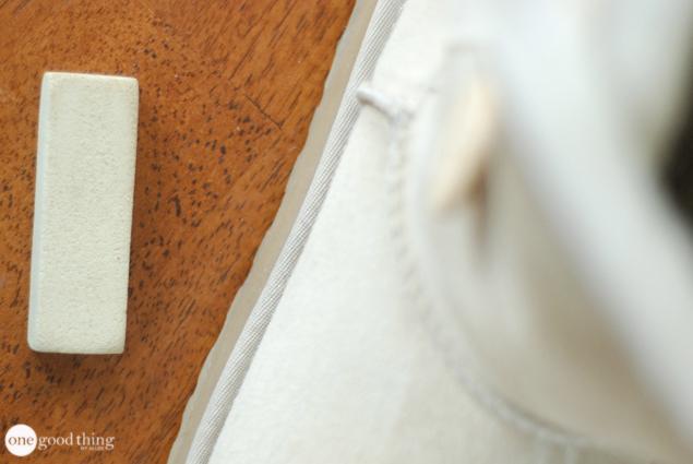 A suede eraser alongside a white Ugg boot