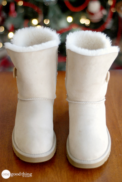 A front view of a pair of clean, white Uggs