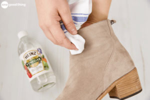 Wipe suede with white vinegar or rubbing alcohol
