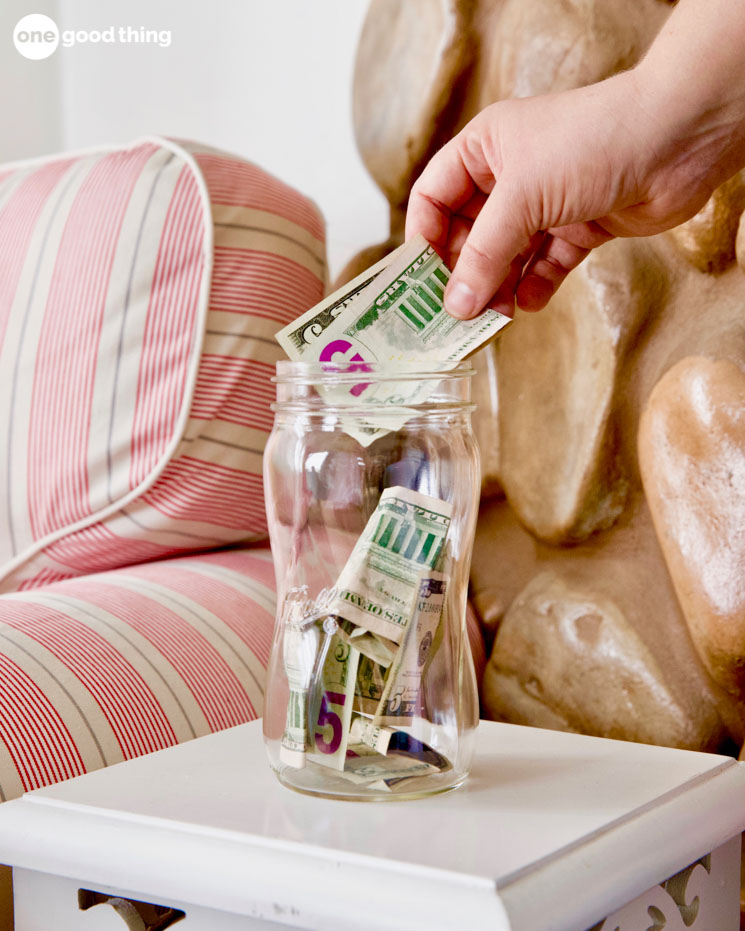 putting money in a jar