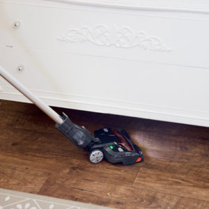 Vacuuming under a dresser