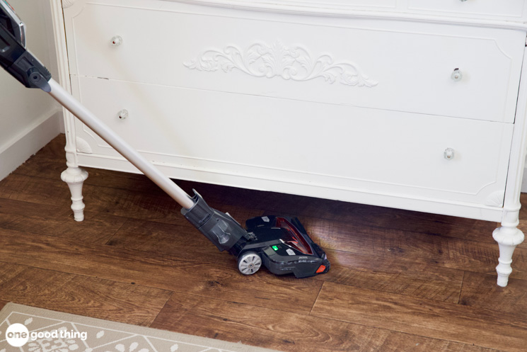 Vacuuming under a dresser