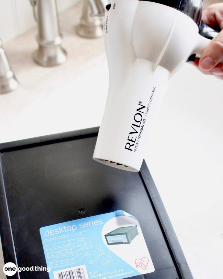removing a label with a hair dryer
