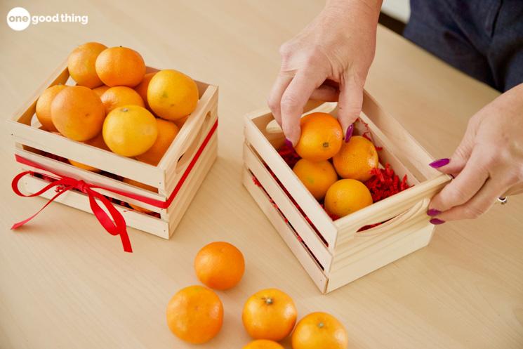 mandarin oranges in a crate