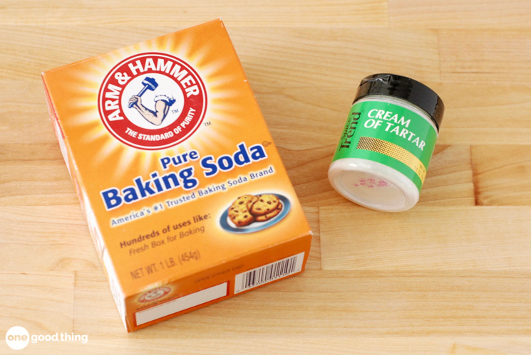 A small box of baking soda and a small container of cream of tartar