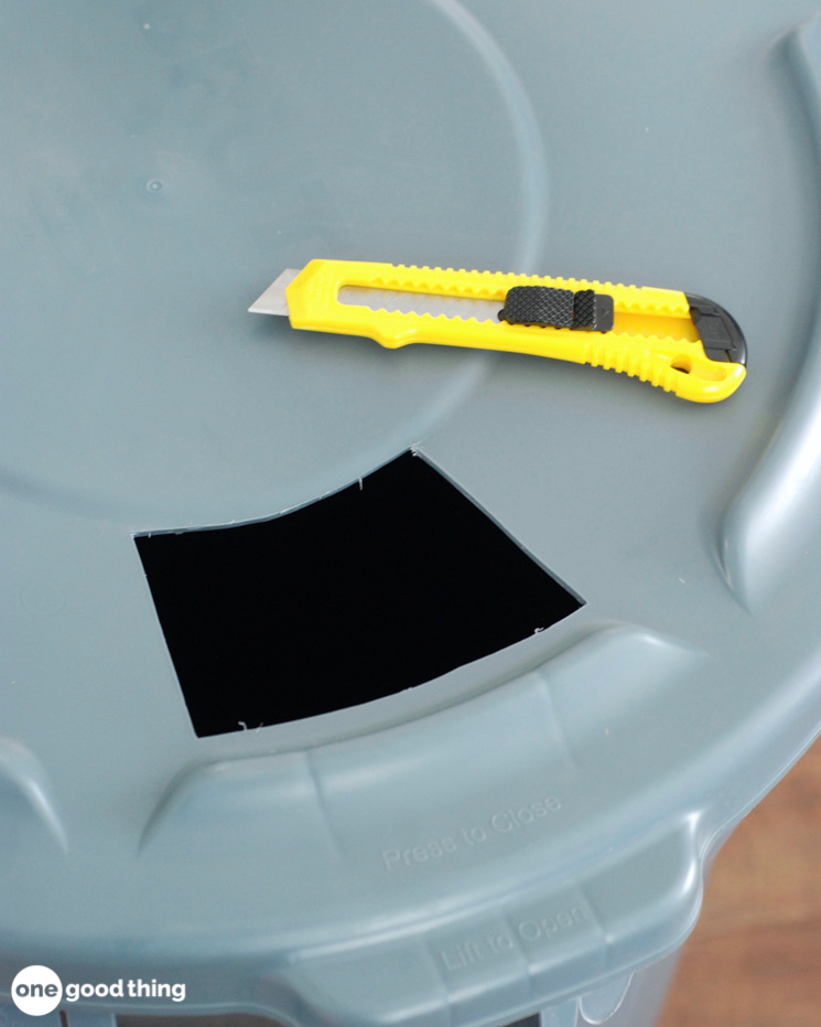 Cut hole in garbage can lid